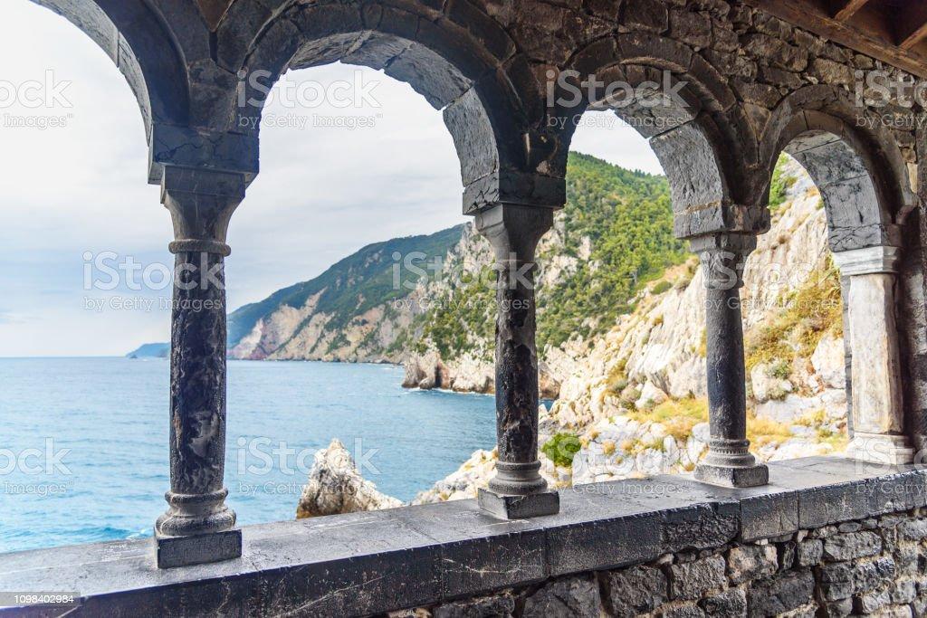 View through columns of Church of St. Peter in Portovenere or Porto Venere town on Ligurian coast. Italy stock photo