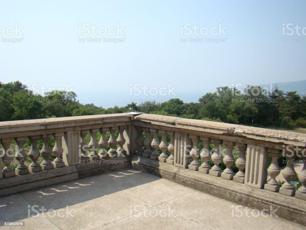 View through concrete balustrades to the sky. stock photo