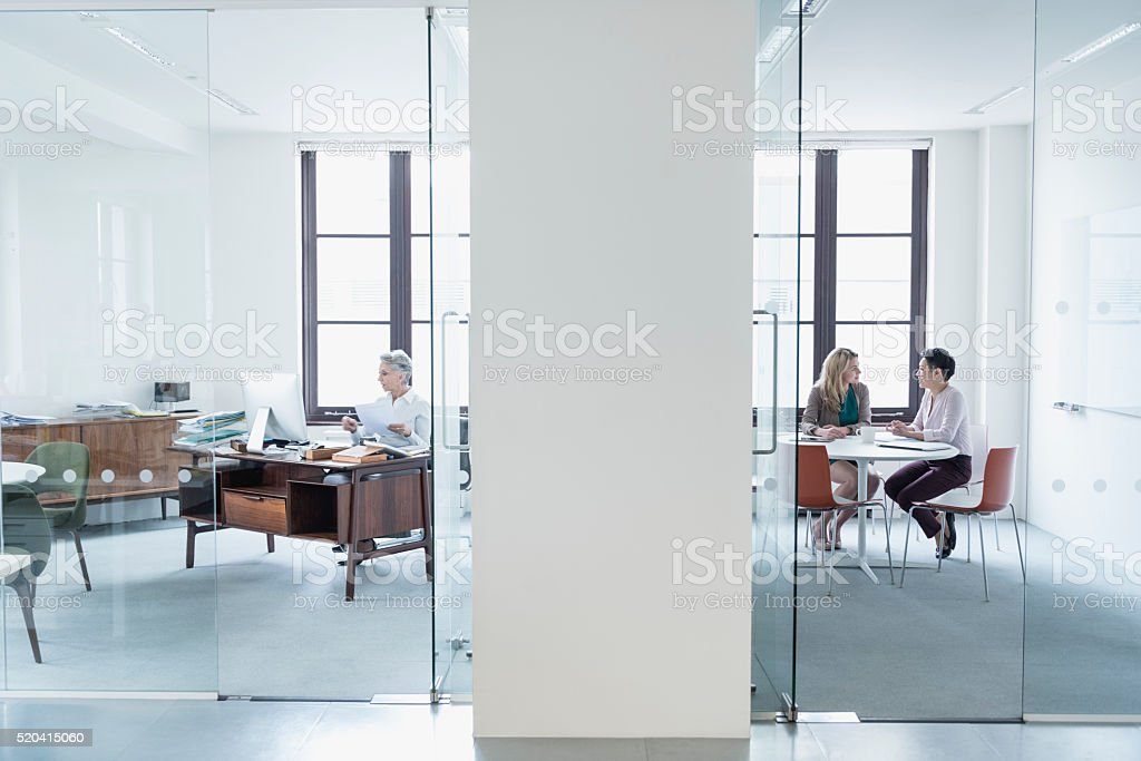 View through glass partition into modern office stock photo