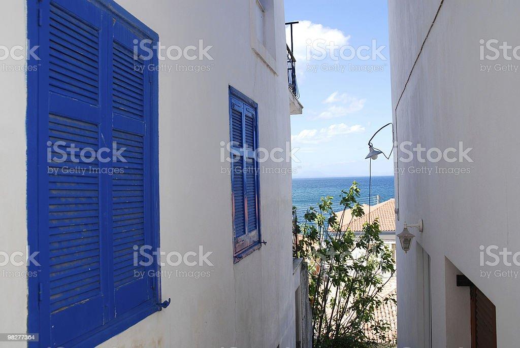 view through greek houses to the mediterranean sea royalty-free stock photo