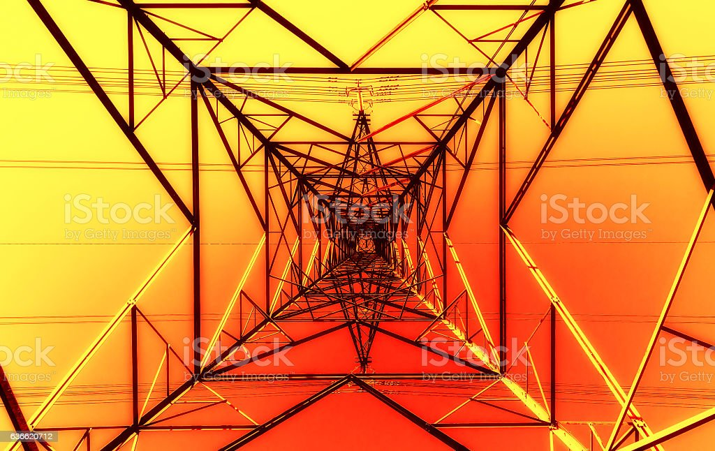 View through the center of an electricity pylon stock photo