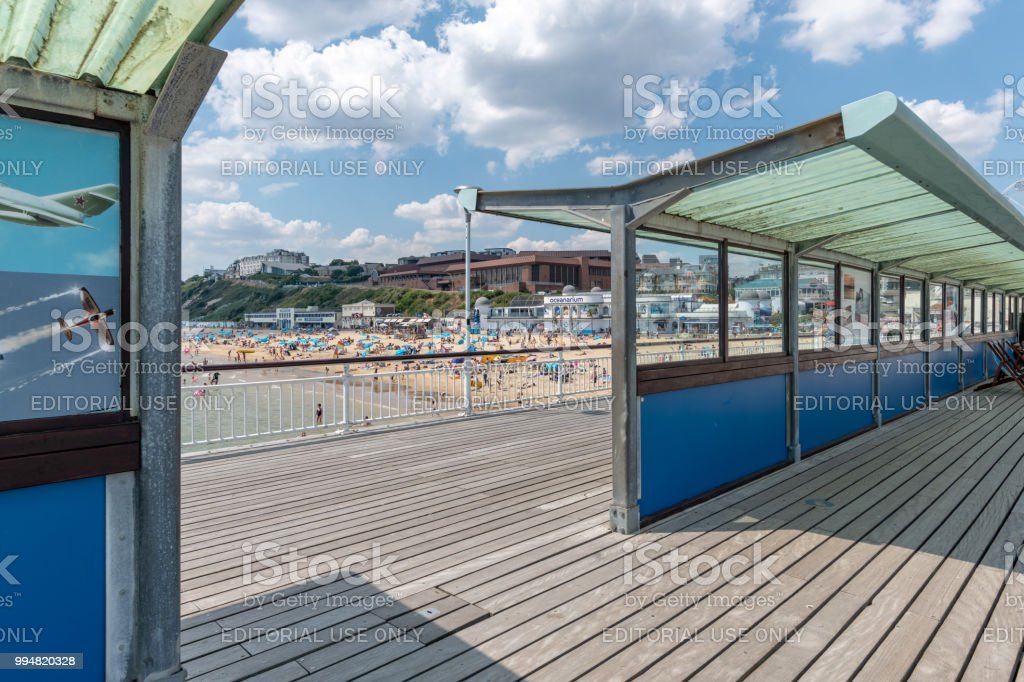 View through the pier to the beach in Bournemouth stock photo