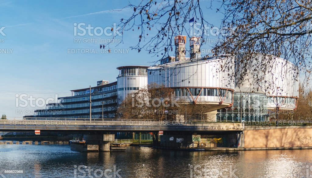 View through trees of the European Court of Human rights bulding stock photo