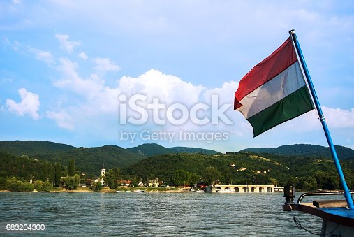 A View To A Church At Visegrad A Small Town At Hungary Near Budapest From A Ship At Danube And A Hungarian Flag At The Foreground - セーリングのストックフォトや画像を多数ご用意