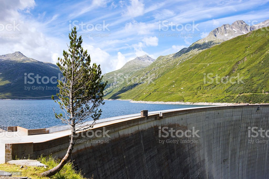 View to a dam that served the production of electricity stock photo
