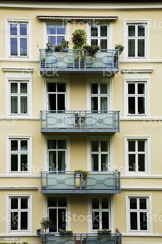 View to a facade of apartment building with balconies. royalty-free stock photo