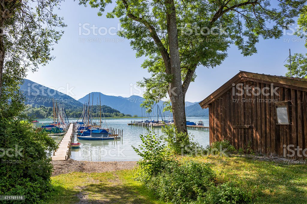 View to a jetty for sailboats at Lake Tegernsee stock photo