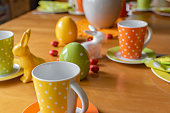 View to a View to a colorful easygoing family breakfast table decorated for Easter.