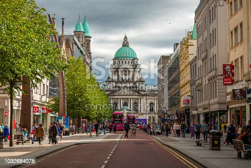 Belfast, Northern Ireland-U.K - July 30, 2018: View along a street to the City Hall in Belfast. Many tourists are around.