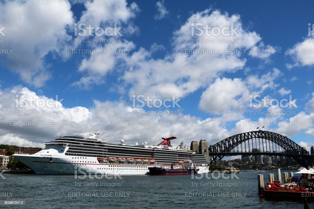 View to Cruise ship and Harbour Bridge at Circular Quay in Sydney, New South Wales Australia stock photo