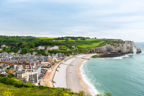 View to Etretat, France from above View from above to the town and the bay of Etretat, France manche stock pictures, royalty-free photos & images