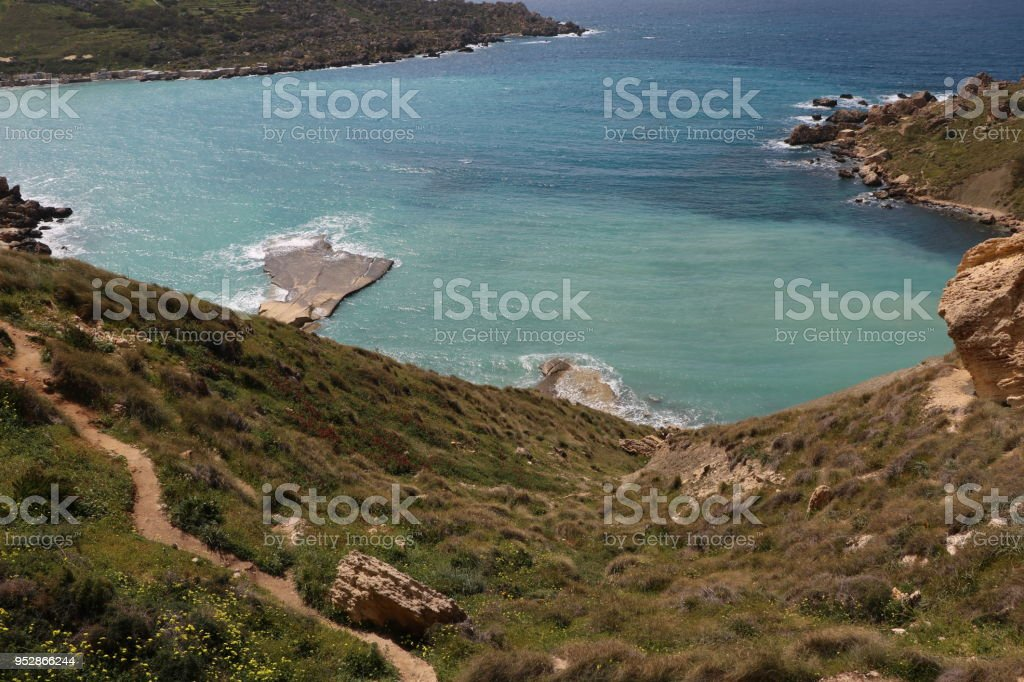 View to Gnejna Bay at the Mediterranean Sea in Malta stock photo