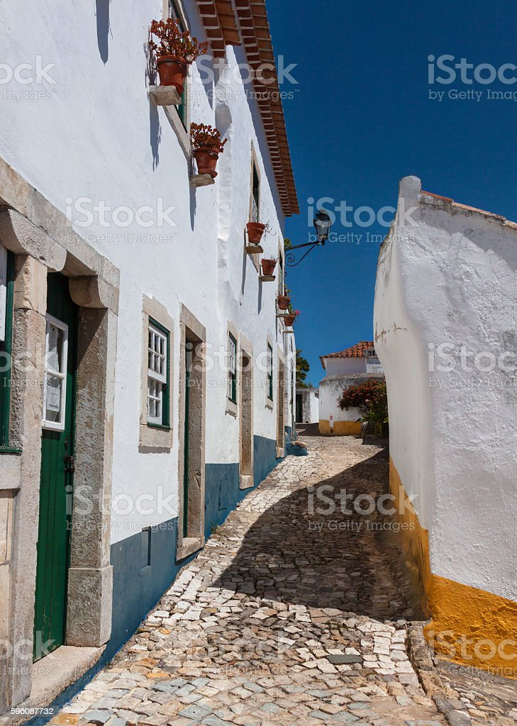 View to Historic narrow street Obidos in Portugal royalty-free stock photo