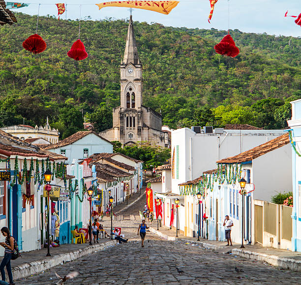 View to old town with church Goias, Brazil - October 17, 2013: people on a cobblestone street in the Unesco world heritage site  in Goias, Brazil. View to old church Igreja do Rosario from 1732. goias stock pictures, royalty-free photos & images