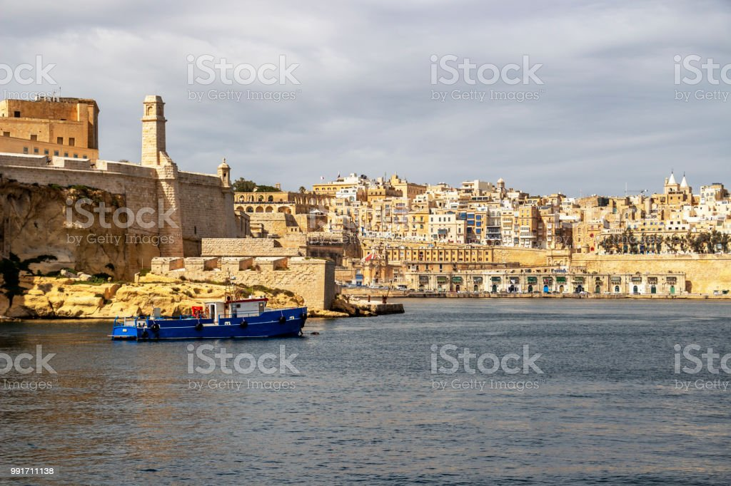 View to part of Fort St. Angelo in Birgu and Valletta with Quarry Wharf, at Grand Harbor, Malta stock photo