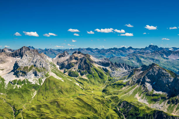view to the alps in austria - европейские альпы стоковые фото и изображения