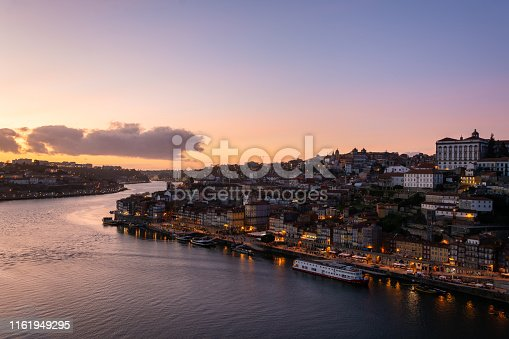 View to the beautiful city of Porto from D. Luis I bridge at sunset