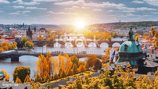 istock View to the historical bridges, Prague old town and Vltava river from popular view point in the Letna park (Letenske sady), beautiful autumn landscape in soft yellow light, Czech Republic 929231168