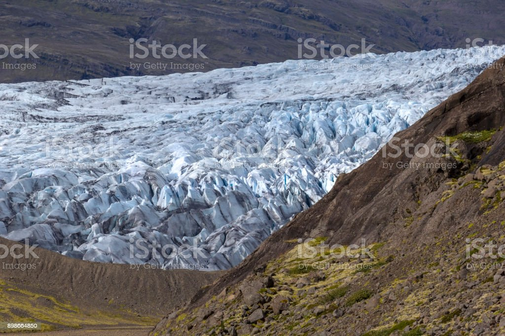 View to the ice front of the glacier Flaajokull in the east of Iceland. stock photo