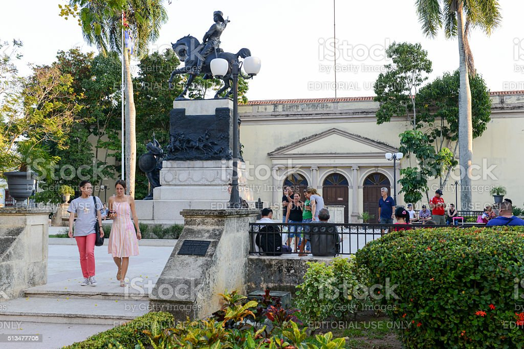 View to the Ignacio Agramonte monument Camaguey, Cuba - 11 January 2016: People walking in front of the Ignacio Agramonte monument at Ignacio Agramonte Park in Camaguey, Cuba Architecture Stock Photo