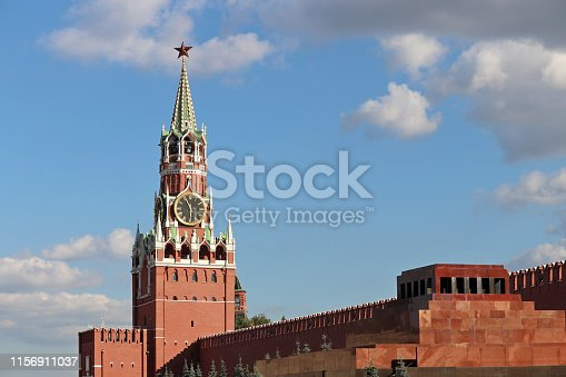 Spasskaya tower against the blue sky with clouds, russian landmarks