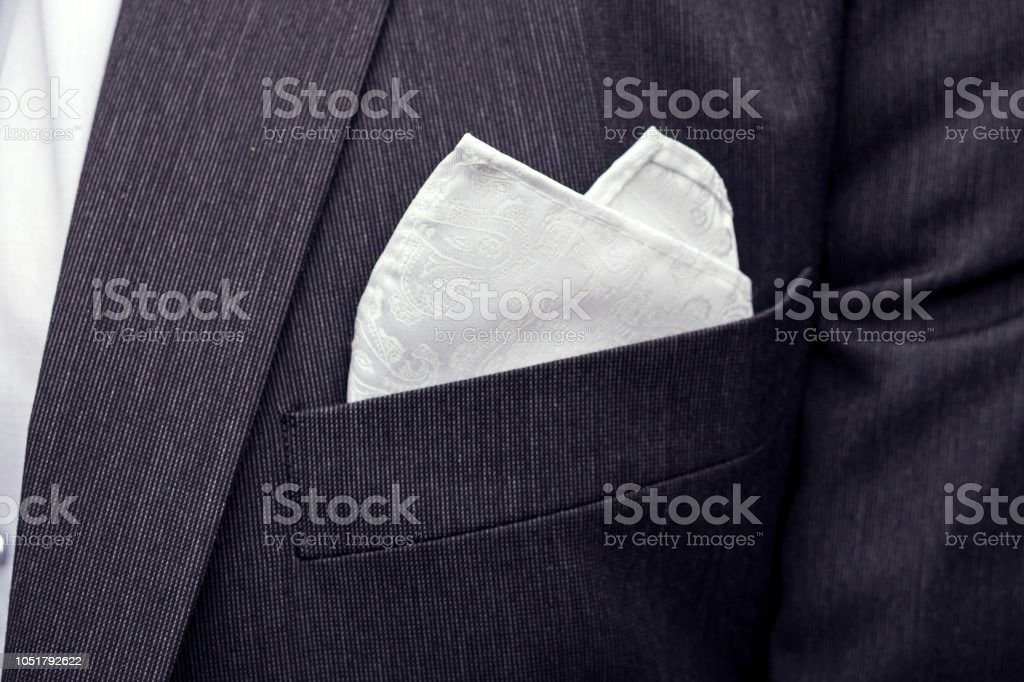 View to the male coat pocket with a fixed white square. Men\'s suit...