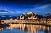 View to the old town and the fortress of Salzburg, Austria, during a clear winter night with starry sky