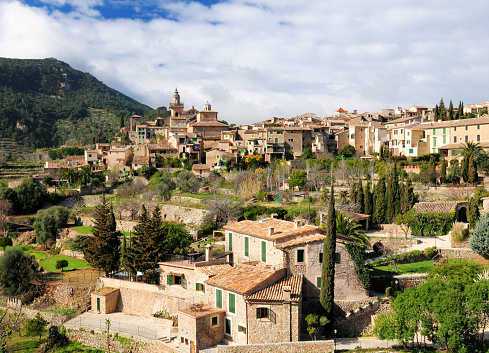 View To The Picturesque Historic Village Of Valldemossa On Balearic Island Mallorca On A Sunny Winter Day With A Few Clouds In The Sky
