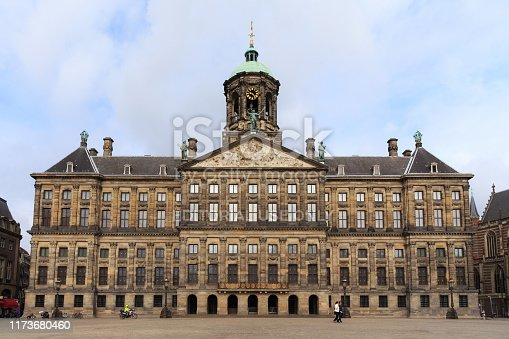 AMSTERDAM, NETHERLANDS - JUNE 25, 2017:  View to the Royal Palace of Amsterdam on the Dam Square. The palace was built as a city hall during the Dutch Golden Age in the 17th century.