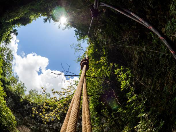 View to the sky at Goa Jomblang Tour near Yogyakarta, Indonesia stock photo