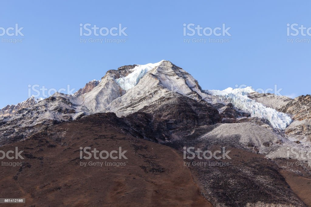 View to the summit of Island Peak from the Island Peak Base Camp. Beautiful Himalayan mountains background. stock photo