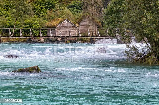 View to the wild river Oldeelva and a little historic mill, Norway.