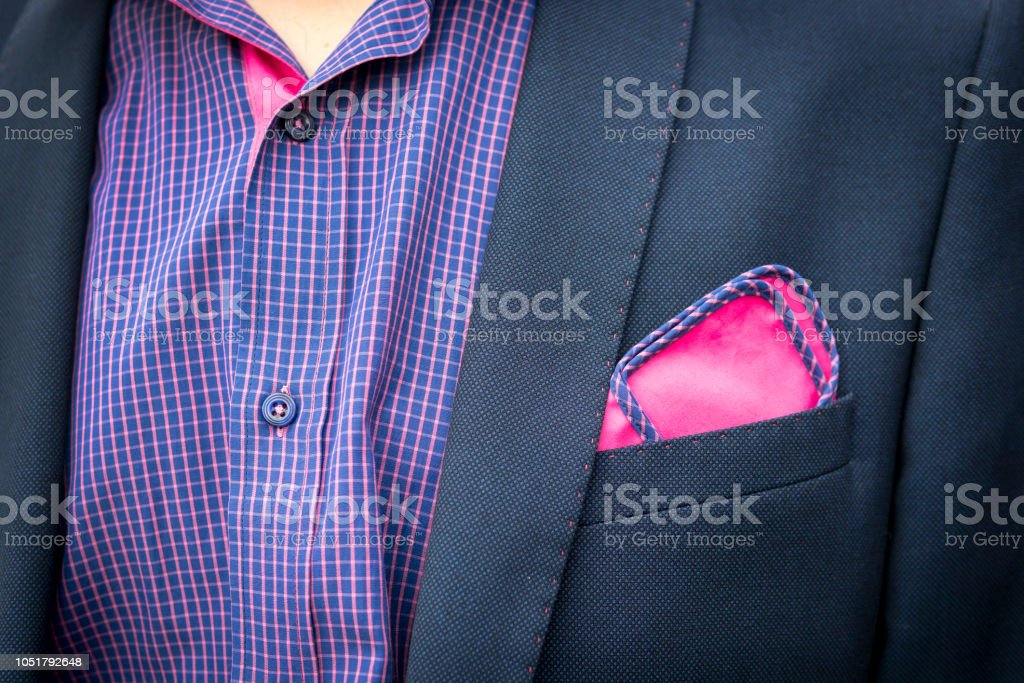 bc240047281df View to the young man's shirt and coat with a pocket a reddish-purple square