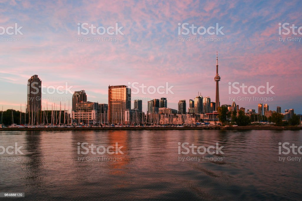 View to Toronto skyline from Ontario Lake in the evening royalty-free stock photo