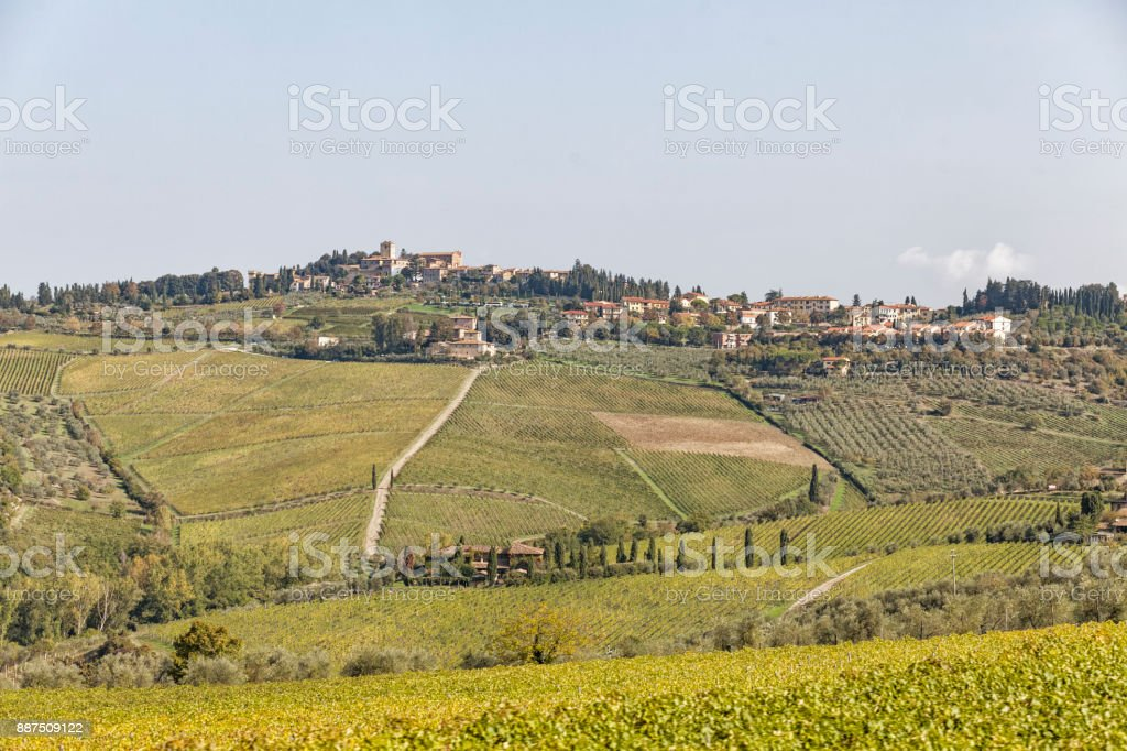 View to town Chastellina in Chianti with vineyards in Tuscany in Italy stock photo