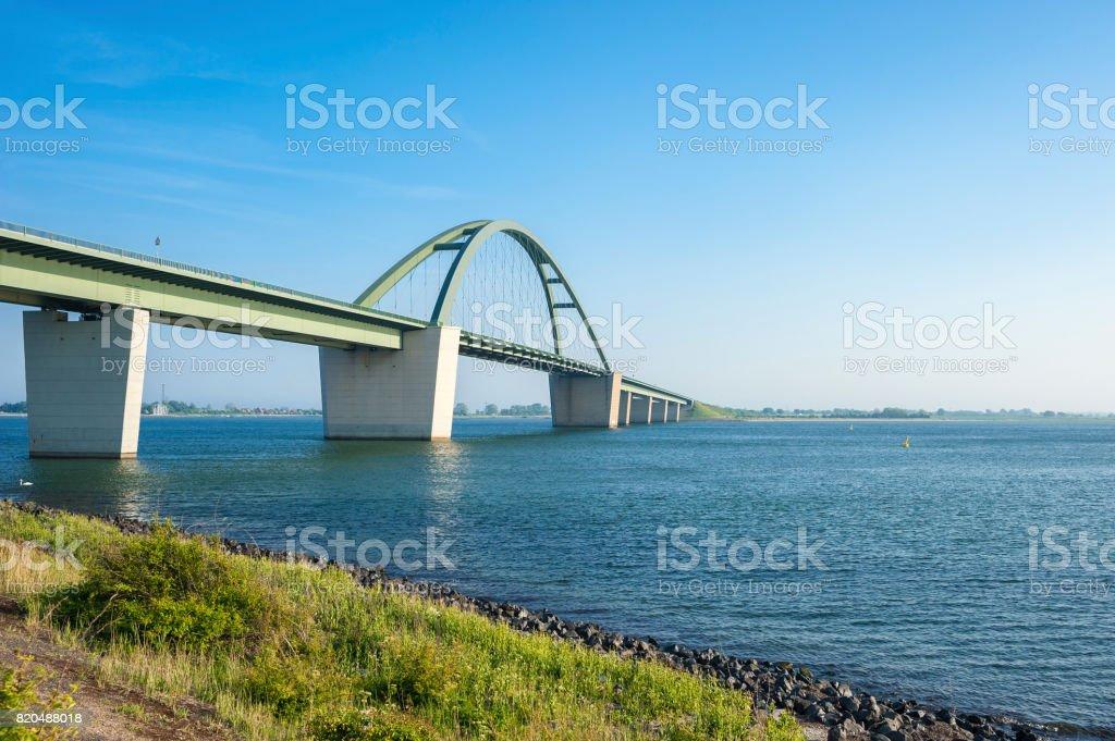 View toward the bridge Fehmarnsundbrücke stock photo