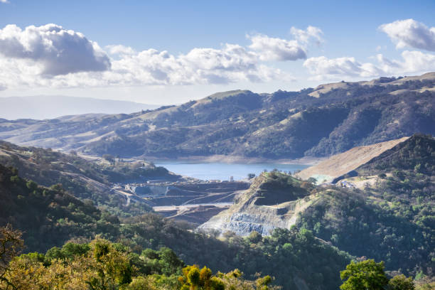View towards Calaveras reservoir, where a new dam is being built;  Calaveras Reservoir is part of the Hetch Hetchy system that captures water in the Sierra; east San Francisco bay area; California View towards Calaveras reservoir, where a new dam is being built;  Calaveras Reservoir is part of the Hetch Hetchy system that captures water in the Sierra; east San Francisco bay area; California alameda california stock pictures, royalty-free photos & images