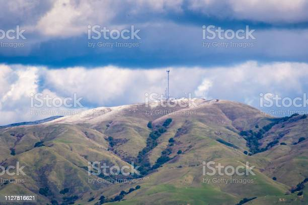 Photo of View towards Monument Peak on a cold winter day; some snow still present on the ground; storm clouds covering the sky; south San Francisco bay area, California
