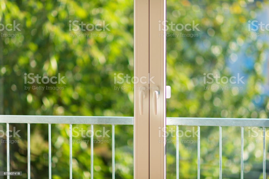 view trough summer window / door with small balcony stock photo