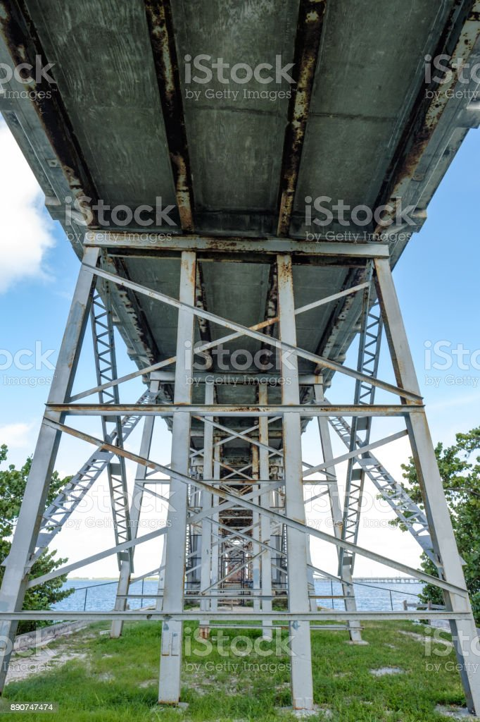 View underneath the Henry Flagler built Overseas Railroad bridge connecting Bahia Honda and Spanish Harbor Key showing the various support methods used stock photo