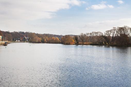 View upstream river Ruhr in Muelheim Menden in autumn