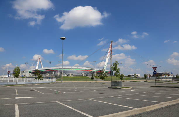 view with parking lot of the juventus stadium - juventus foto e immagini stock