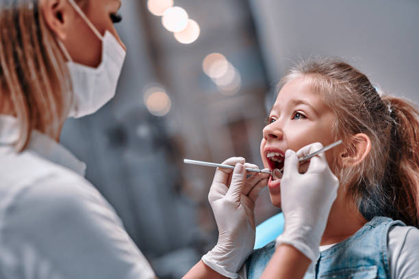 Viewed oral hygiene. Child to the dentist. Viewed oral hygiene. Child to the dentist. Child in the dental chair dental treatment during surgery. streptococcus mutans stock pictures, royalty-free photos & images