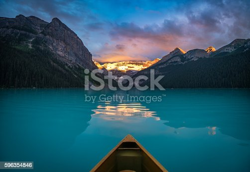 It's quite an awesome experience to wake up early and enjoy the Lake Louise sunrise from inside a canoe.