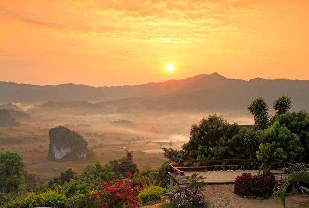 Viewpoint beautiful sunshine at misty morning mountains ,Phulangka National Park, Payao Province,thailand