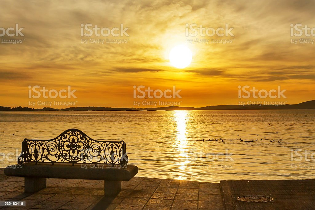 Viewpoint bench at sunset stock photo