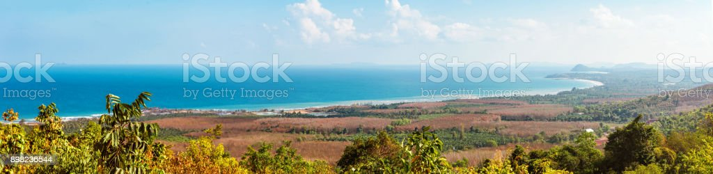 Viewpoint on Chumphon coastline from Buddha gold statue at Wat Khao Chedi-Phra Yai temple located on top of hill, Pathio, Chumphon district, Thailand stock photo