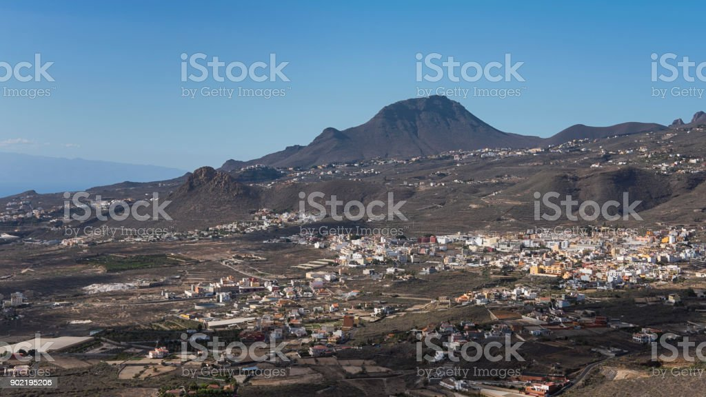 Views from Mirador La Centinela towards Valle San Lorenzo village, the mountain formation Roque del Conde, and the island of La Gomera in the background, in Tenerife, Canary Islands, Spain stock photo