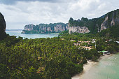 Views from the viewpoint of the Blue Lagoon trek of the Railay (Rai Leh) peninsula in Krabi, Thailand during sunny day. Both west and east beaches are visible.