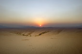 Views of sand dune with a sunset sky background